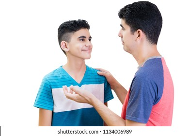 Latin father is having a chat with his teenager son isolated on white