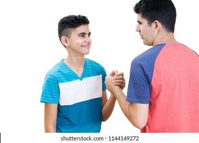 Latin father and his teenager son shaking their hands isolated on white