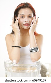 latin female cleaning her face with soap