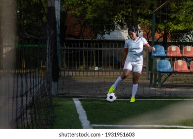 Latin female soccer player ready to kick a corner. Female football player concept