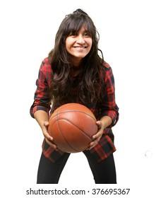 latin girl playing basket