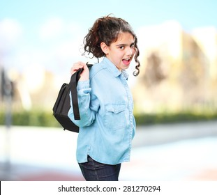 latin girl with satchel on the street
