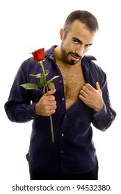 A latin guy with rose with a seductive look.
