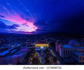 Latin historic city view with purple sky and raining coming. san salvador, El salvador