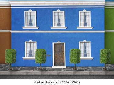 A latin house in a a street behind some beautifully cut trees