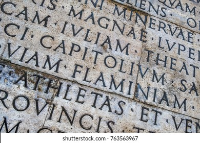 Latin inscription on the outside wall of Ara Pacis wall in Rome, Italy