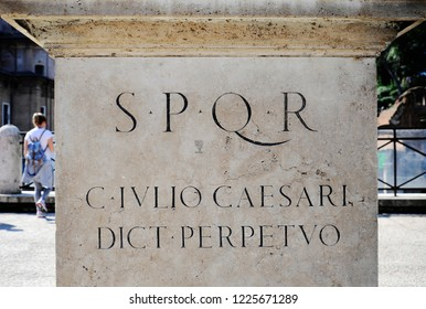 Latin inscription on the statue of Gaius Julius Caesar at the imperial forums of ROME. (translate: Gaius Julius Caesar, perpetual dictator). Rome, Italy