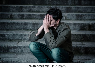 latin man stressed from work sitting on steps outside feeling anxiety in adult cause of depression and problem in living that makes you feel lonely, sad and worried in mental health concept