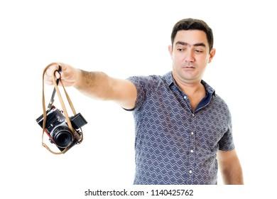 Latin man throw away his old camera