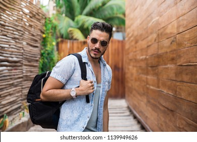 Latin man traveling in Tulum, Mexico.