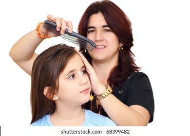 Latin mother combing her beautiful daughter hair isolated on a white background