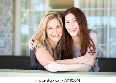 Latin Mother and teen daughter.