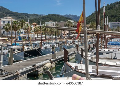 Latin sailing ships, are lined up on the jetty. Marina view port in balearic village of Port-Soller, Majorca island, Balearic Islands, Spain.