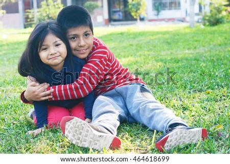 latin siblings hugging park stock photo edit now 464618699