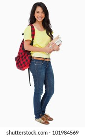 Latin student with backpack holding textbooks against white background