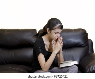 Latin teenager girl having a daily Christian devotional at home