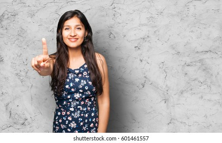 latin woman doing number one gesture