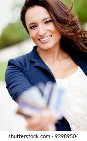 Latin woman holding credit cards - financial solutions