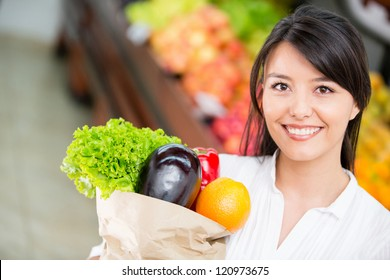 Latin woman shopping for groceries at the marketplace