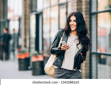 Latin woman with smartphone speak with friends