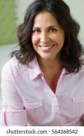 Latin woman smiling.