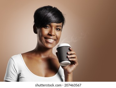 latin woman smiling and holding coffee on a warm beige background