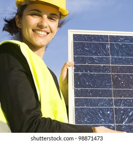 Latin woman with a solar panel