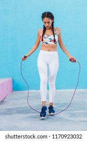 Latin woman working out in trendy sportswear