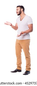 Latin young man talking to companion and gesticulates with both hands. Full length portrait. Isolated on white background.