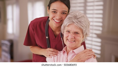 Latina caretaker with senior woman smiling