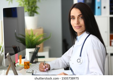 Latina female adult doctor facial portrait aganist hospital office backround. Medical education concept