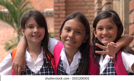 Latina Female Students And Friendship Wearing School Uniforms