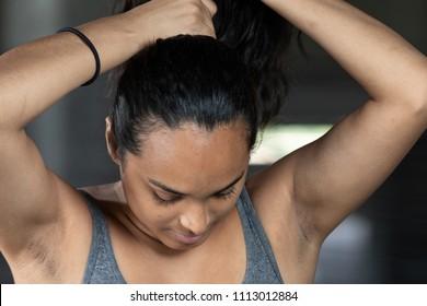 Latina woman fixing her ponytail