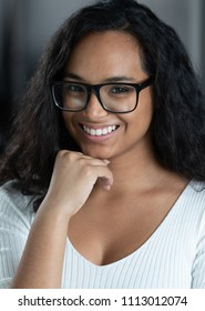 Latina woman with glasses