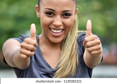 Latina Youth With Thumbs Up