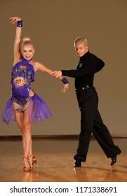 latino dance couple in action  preforming a exhibition dance - wild samba
