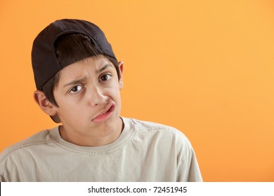 Latino kid making funny faces with his mouth