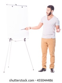 Latino tutor pointing at flip chart. Looks like he is trying to explain something really important. Full length portrait isolated on white background.