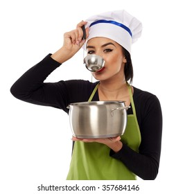 Latino woman chef tasting soup with a ladle, isolated on white