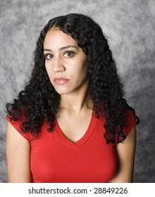 Latino woman portrait in a red dress