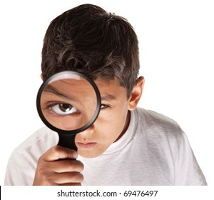 Latino youth looking through a magnifying glass