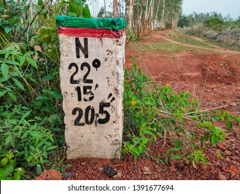Latitudes and longitudes marking post.