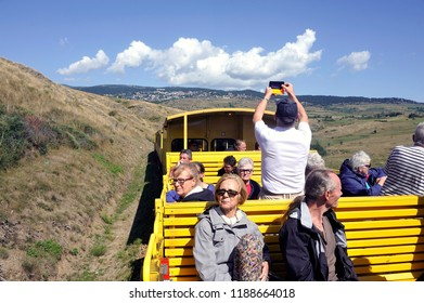 LATOUR DE CAROL, FRANCE - SEPTEMBER 4, 2018: The small yellow trains of the Pyrenees crossing a beautiful mountain landscape