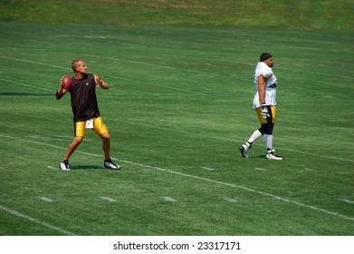 LATROBE, PA - JULY 29, 2008: Pittsburgh Steelers team practicing at training camp at St. Vincent College in Latrobe Pennsylvania for the 2008 2009 football season.  Ben Roethlisberger with football.