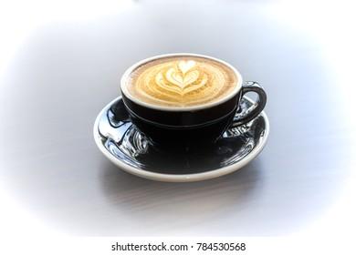 Latte are aromatic cappucino coffee serve in a black cup