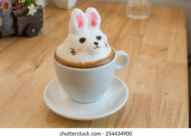 Latte Art 3D. Made by milk foam top on the cup of hot coffee or hot chocolate. build it to thing that customer love. place on the wood table