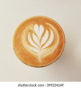 latte art of latte or cappuccino coffee in retro filter effect