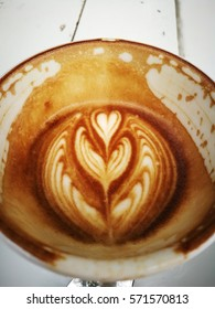 Latte art on wooden table