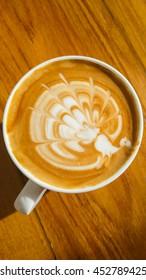 latte art in peacock shape