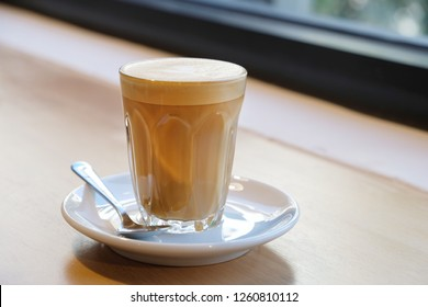 Latte coffee cup. A latte is a coffee drink made with espresso and steamed milk. The term as used in English is a shortened form of the Italian caffè latte, caffelatte or caffellatte.